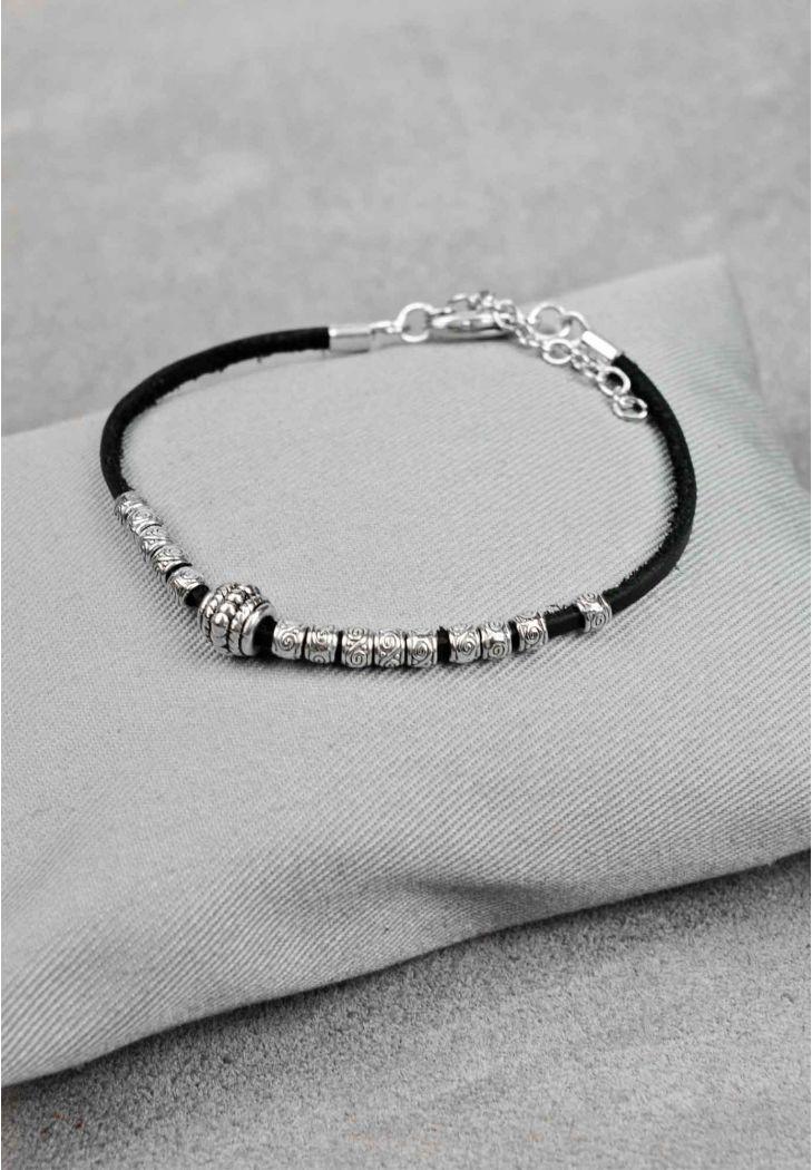 Фото Женский кожаный браслет с металлическими бусинами черный